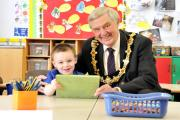 Bob Robinson with his grandson Lewis on his visit to Moulton School last April.