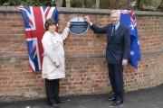 Christine Falland, granddaughter of Hartford crew member Gerry Crowe, and David Briggs, the Lord Lieutenant of Cheshire, formally unveil the plaque.
