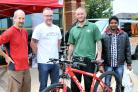 Steve Hall, from Gadbrook Park's Bike to Work Day, and Richard Wilding, from Wild Bikes, with Mark Bowyer, from Roberts Bakery, who won first prize of a bike for taking part in the initiative and Elangovan Anand, from The Hut, who won third prize.