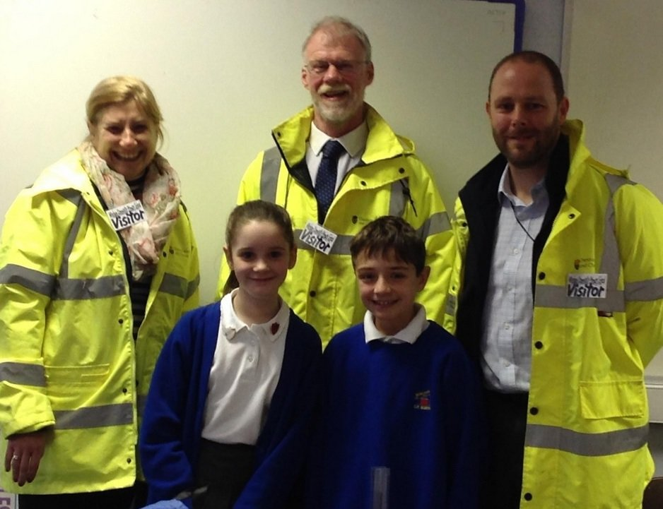 School junior road safety officers Nat Pritchard-Jones and Catherine Lever welcome highway officers from the Cheshire West and Chester Council