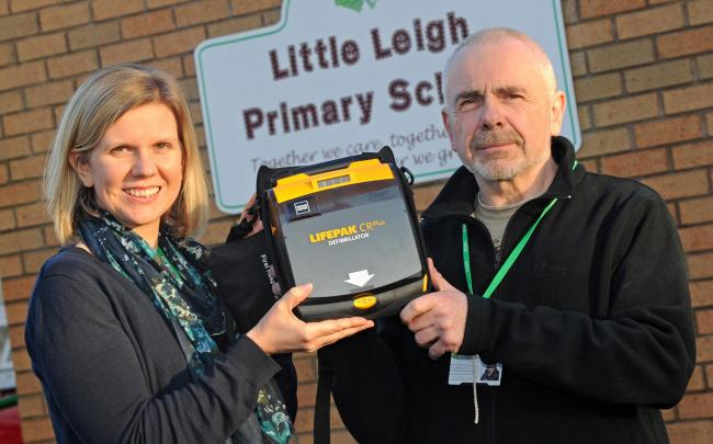 Acting head teacher Kim Cairns and site manager Shaun Agnew show the defibrillator