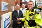 Cheshire Police and Crime Commissioner John Dwyer, Tarporley Fire Station manager Matthew Barlow and Chief Inspector Simon Meegan open the Contact Point.