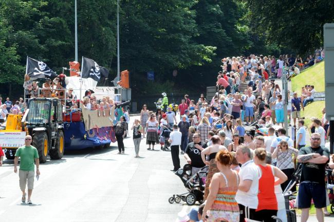 The parade traditionally enters Verdin Park through the gates at the bottom of Castle Hill