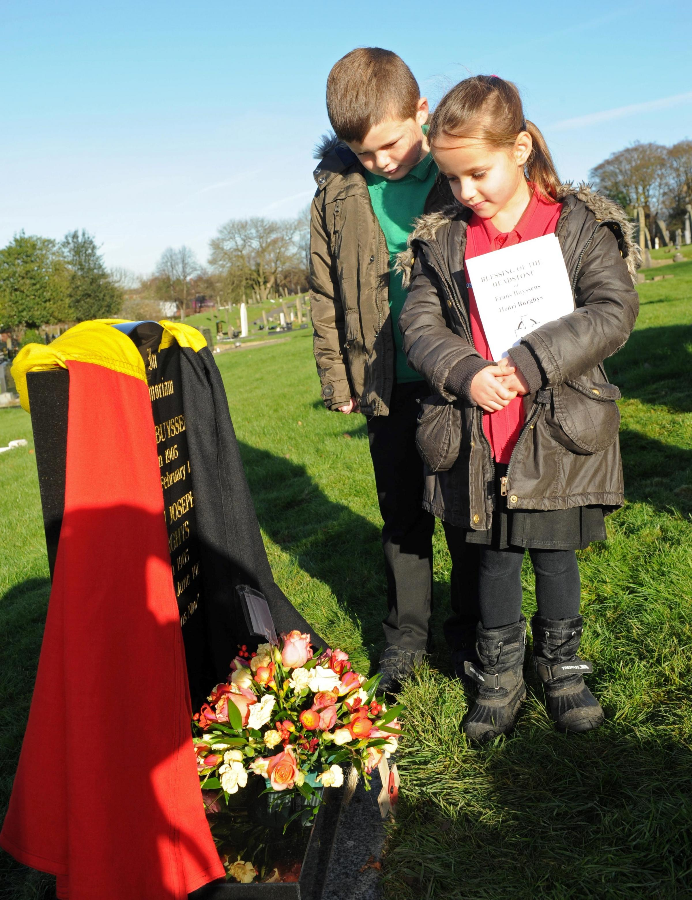 War grave Northwich. Pictured are pupils Alice Barstow aged 6and Olly Robinson aged 7, from Winnington Park school..
