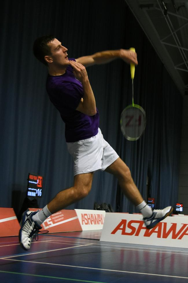 A flying Greg Mairs on the badminton court. Picture by Capture the Event