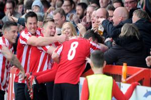 Witton Albion's players celebrate after Brad Bauress gives them the lead in Saturday's promotion play-offs final against Spalding United. Picture: Paul Heaps