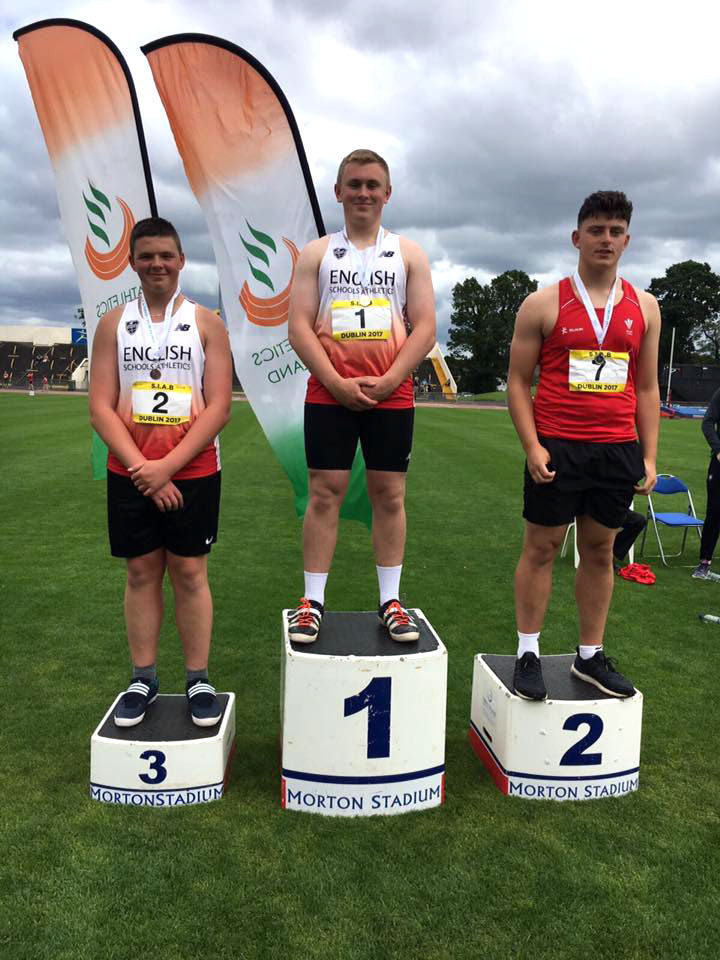 Weaverham High School student George Hyde stands on the podium's top step after winning the boys' shot put while representing England last Saturday
