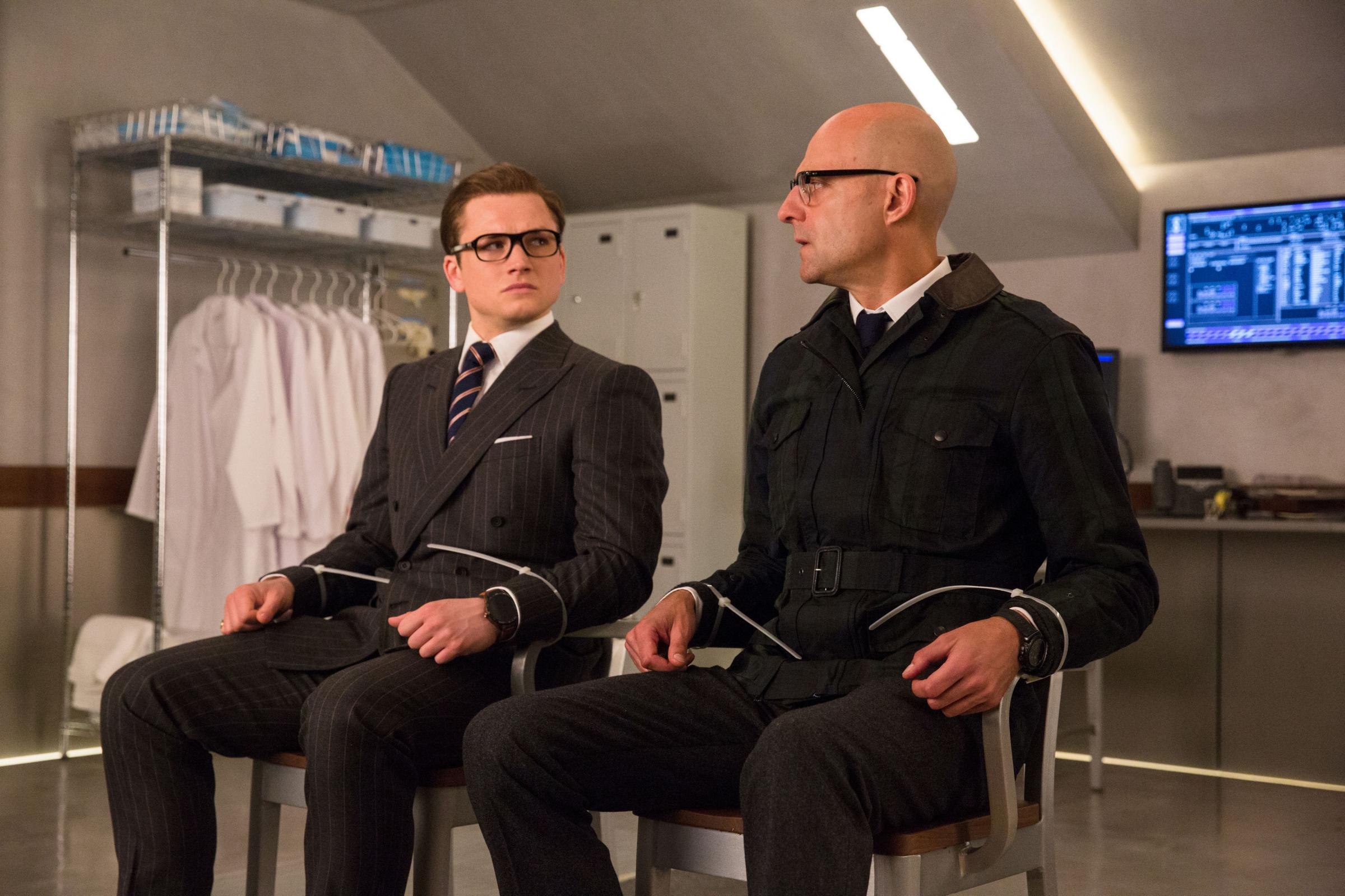 Taron Egerton as Eggsy and Mark Strong as Merlin