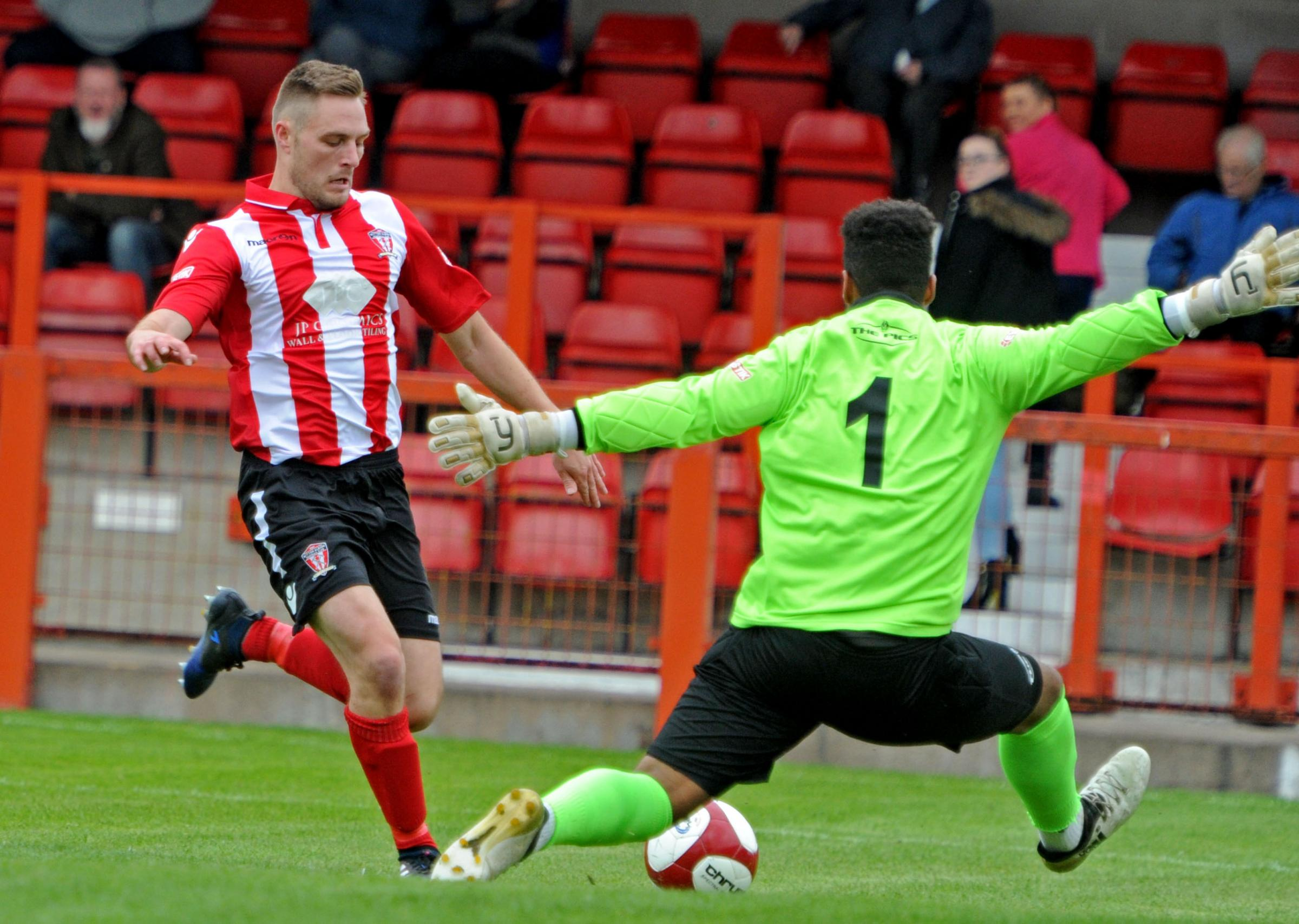 Steven Tames, the scorer of Witton's penalty, is one on one with Rushall keeper Jonathan Brown. Picture by Paul Heaps