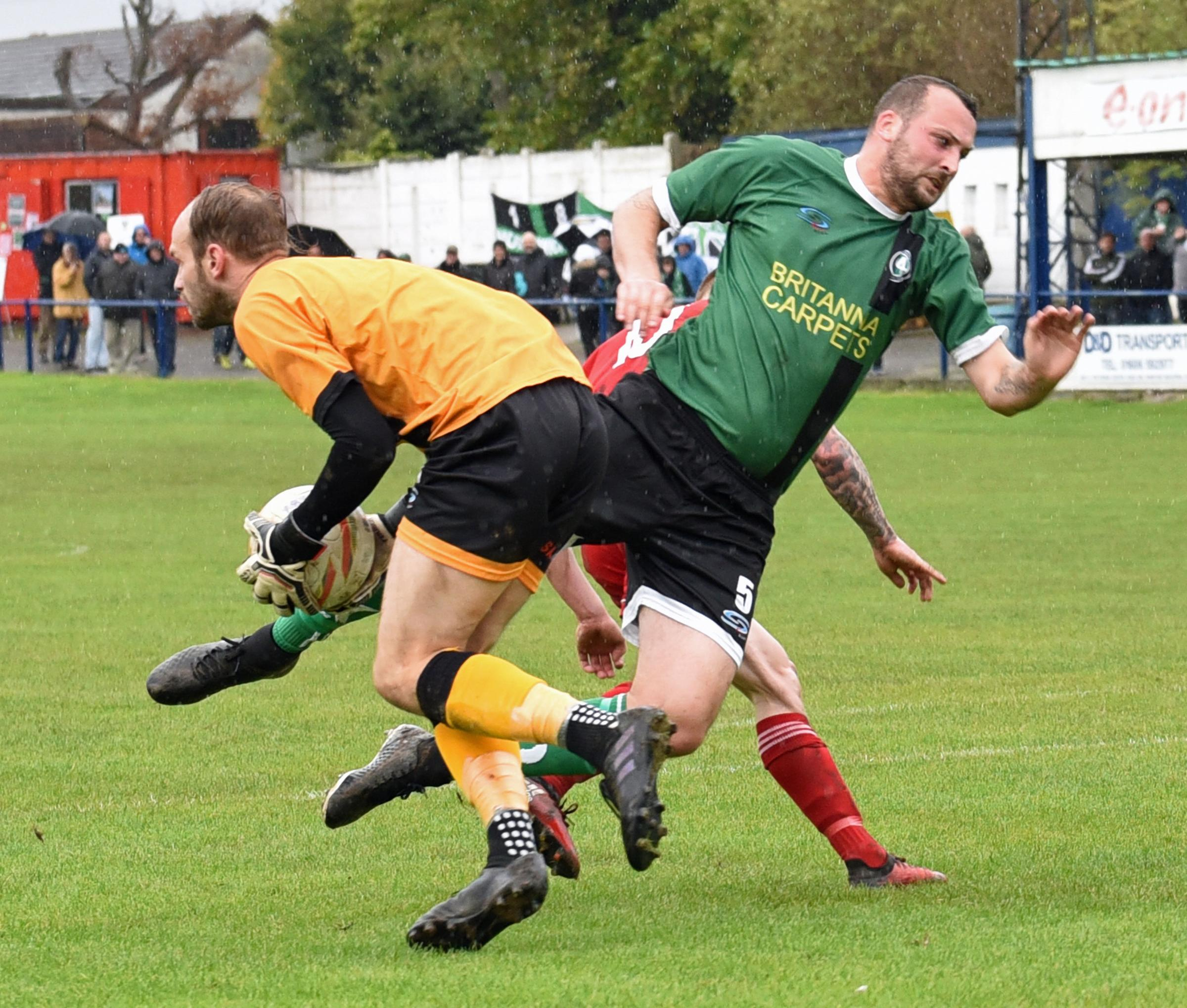 1874 Northwich goalkeeper Greg Hall collects the ball after Danny Meadowcroft, right, shields him from an Ossett Town attacker. Picture: Ian Dutton