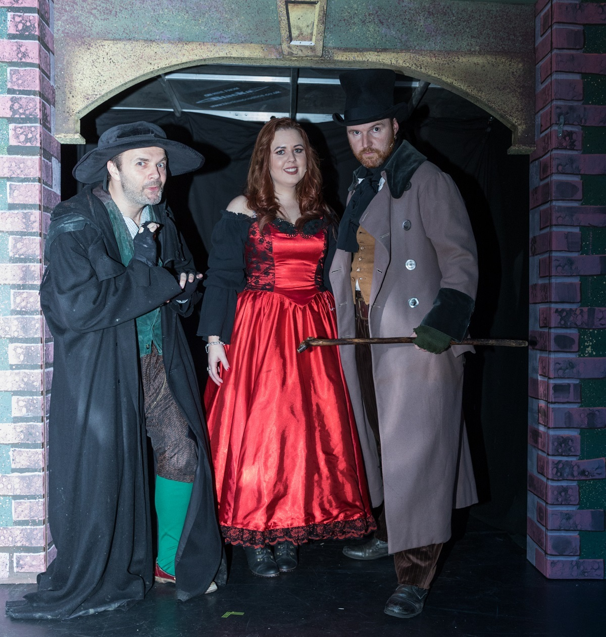 From left to right:Richard Ross as Fagin, Domonique McClafferty as Nancy, Peter McClafferty as Bill Sykes