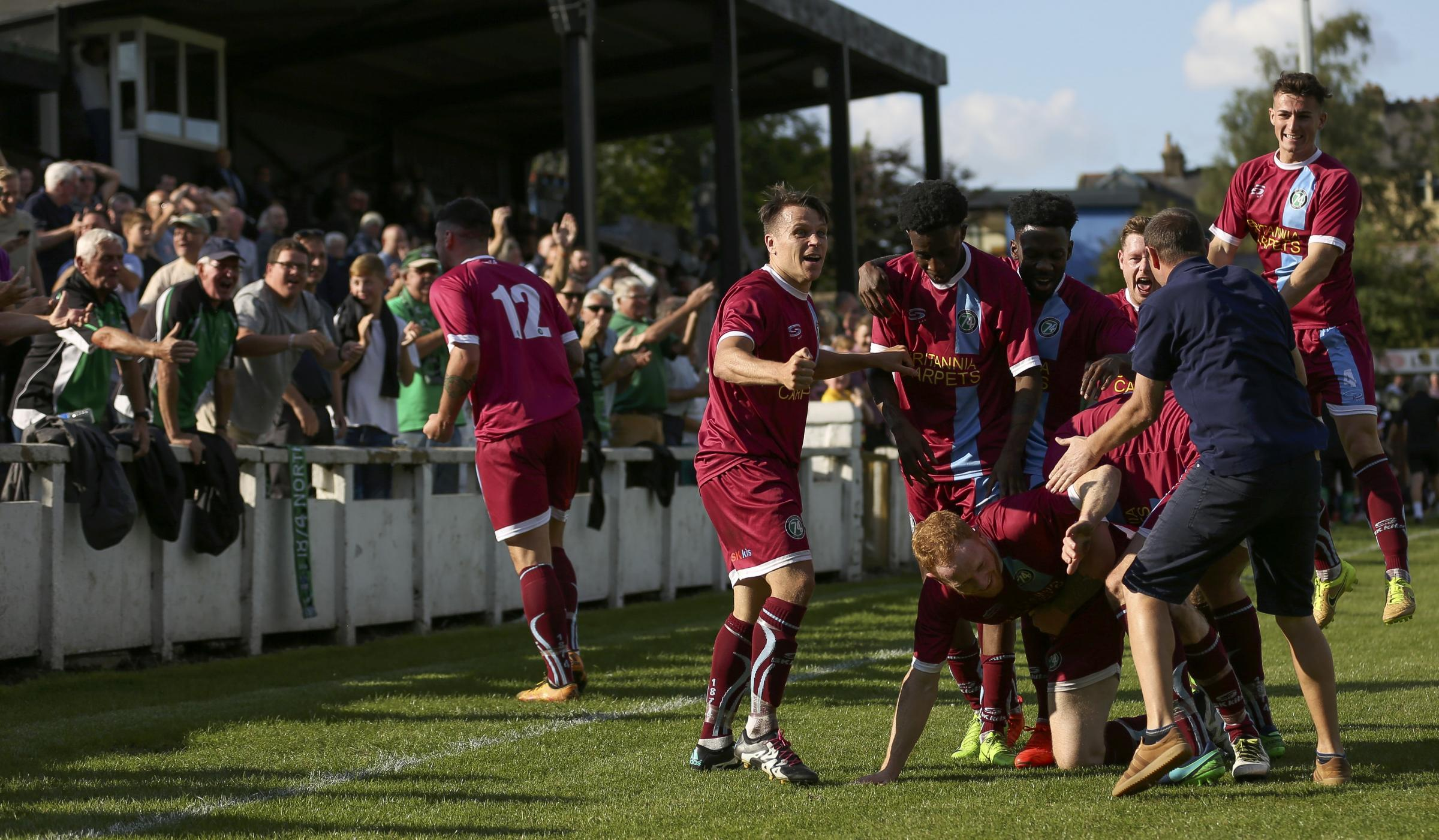 1874 Northwich players celebrate a late equaliser with supporters during an FA Cup meeting with Mossley back in September. Picture: M Darlington Photography