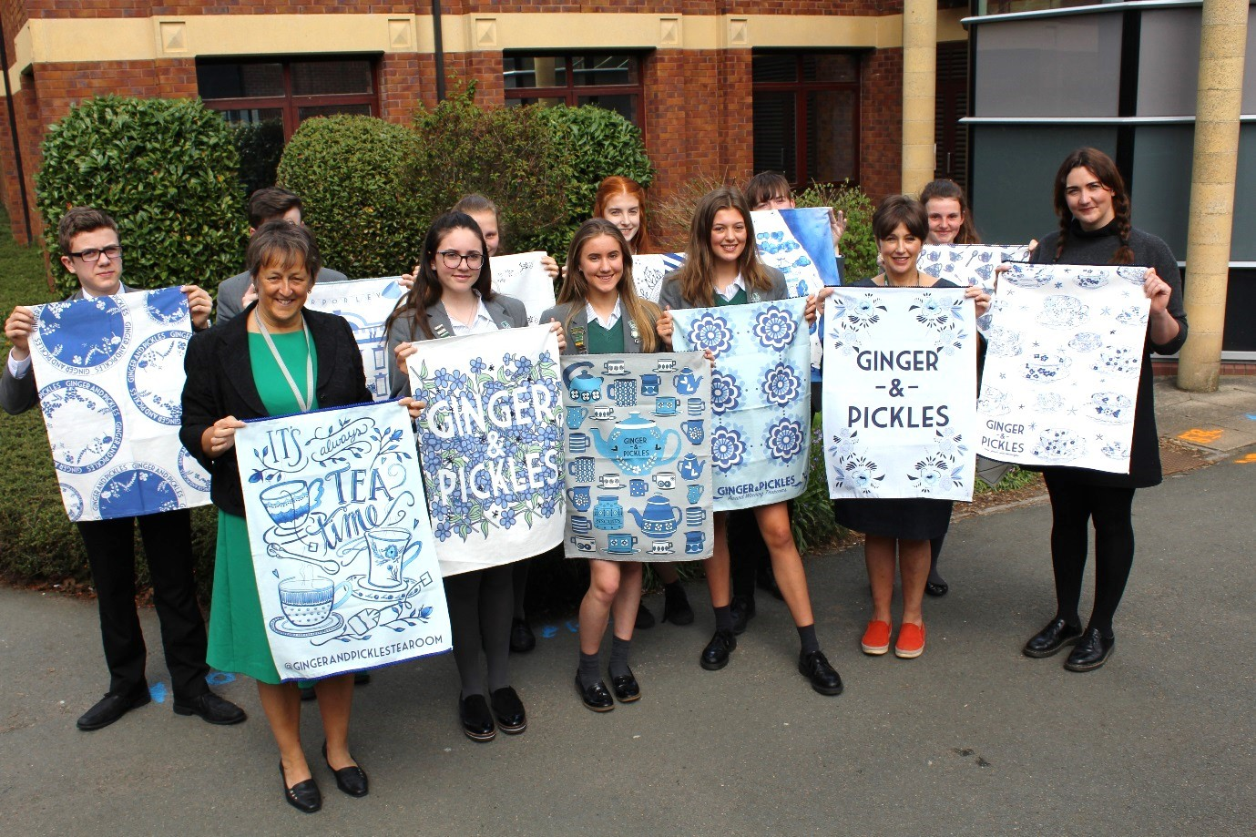 Grange textile students with their designs