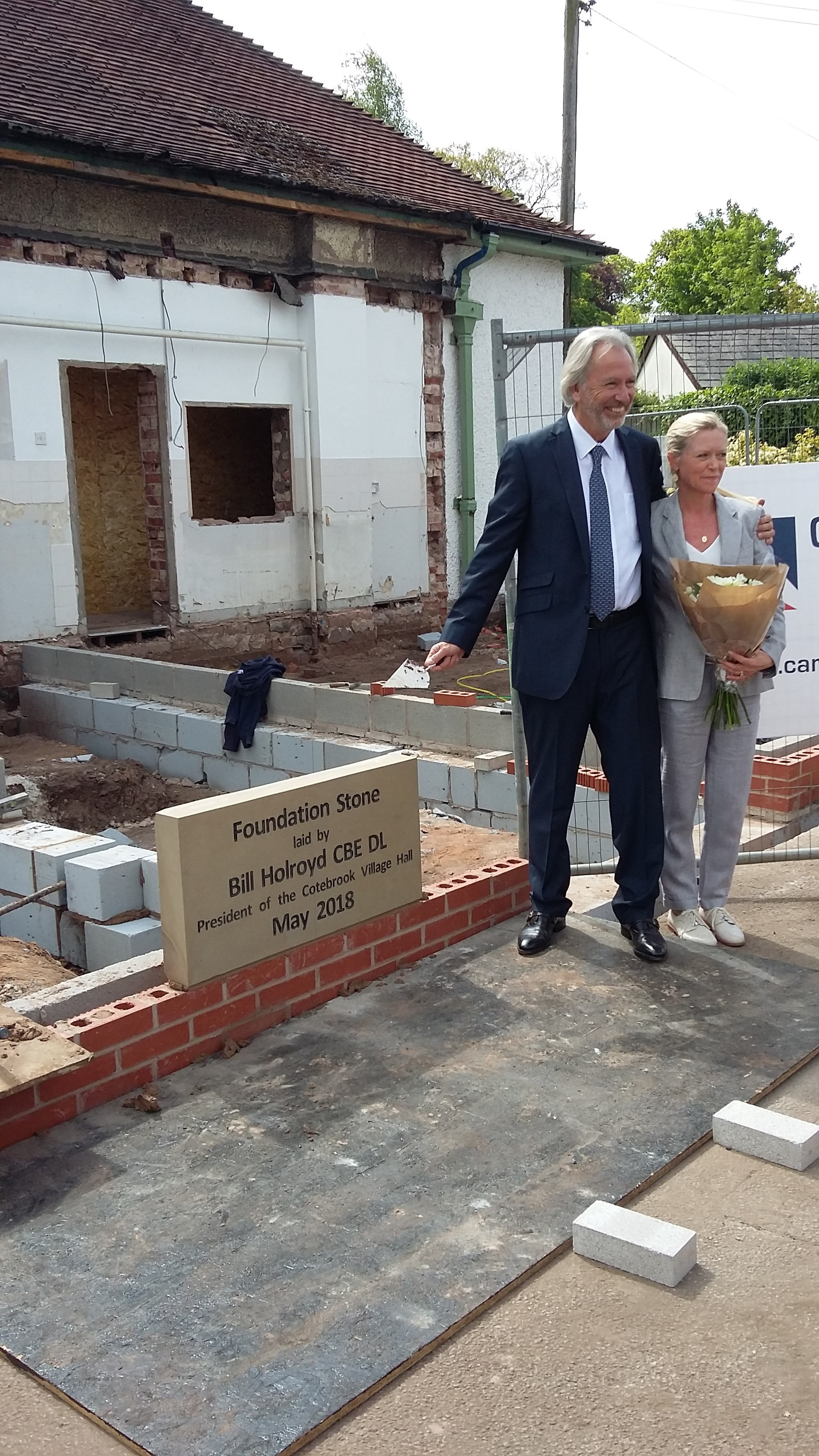 Bill Holroyd and his wife Julie lay the foundation stone at Cotebrook Village Hall
