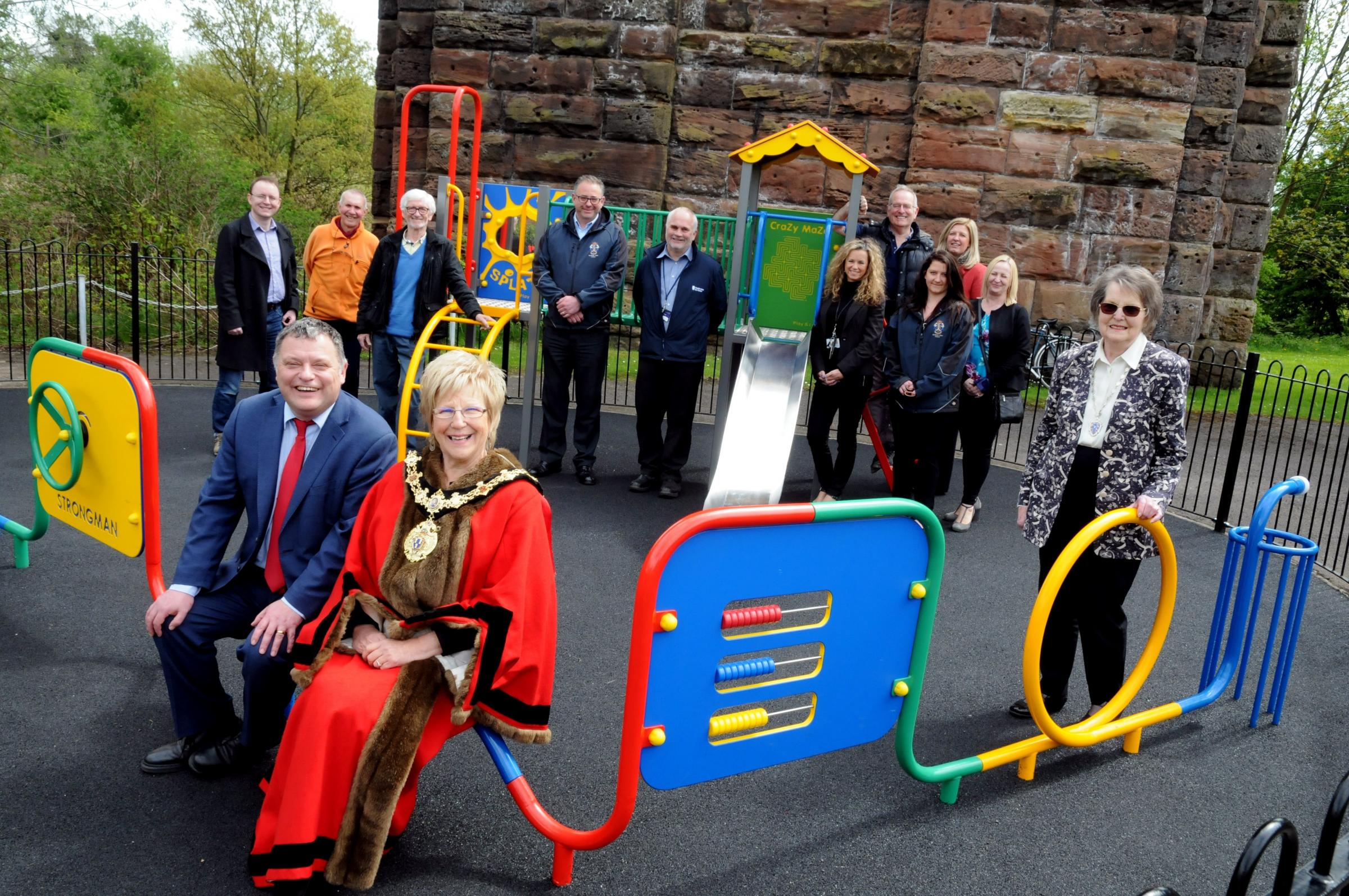 Town mayor Cllr Janet Myerscough-Illidge, MP Mike Amesbury, town council members and staff celebrate the reopening of Yarwood Close play area following extensive work