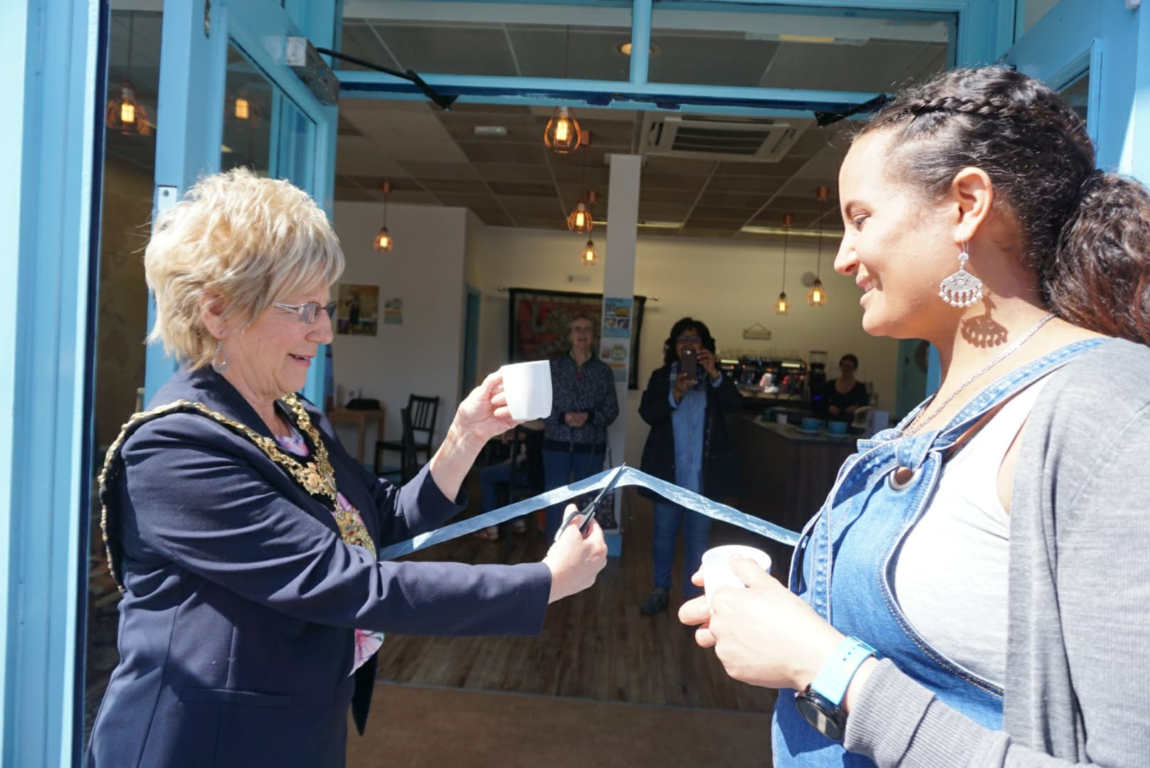 Northwich mayor Cllr Janet Myerscough-Illidge cutting the ribbon with Abda Obeid-Findley