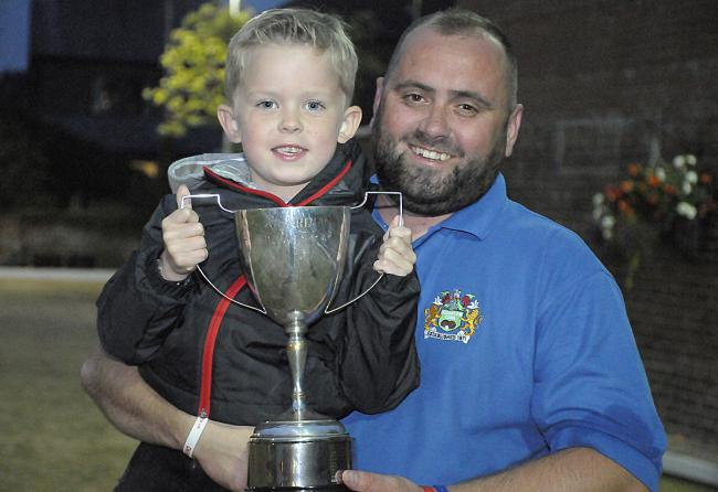 Jimmy Harrop and his son, Finley, show off the Guardian Cup trophy claimed by the Wharton Cons star following his victory in Friday's final. Picture: Mike Boden