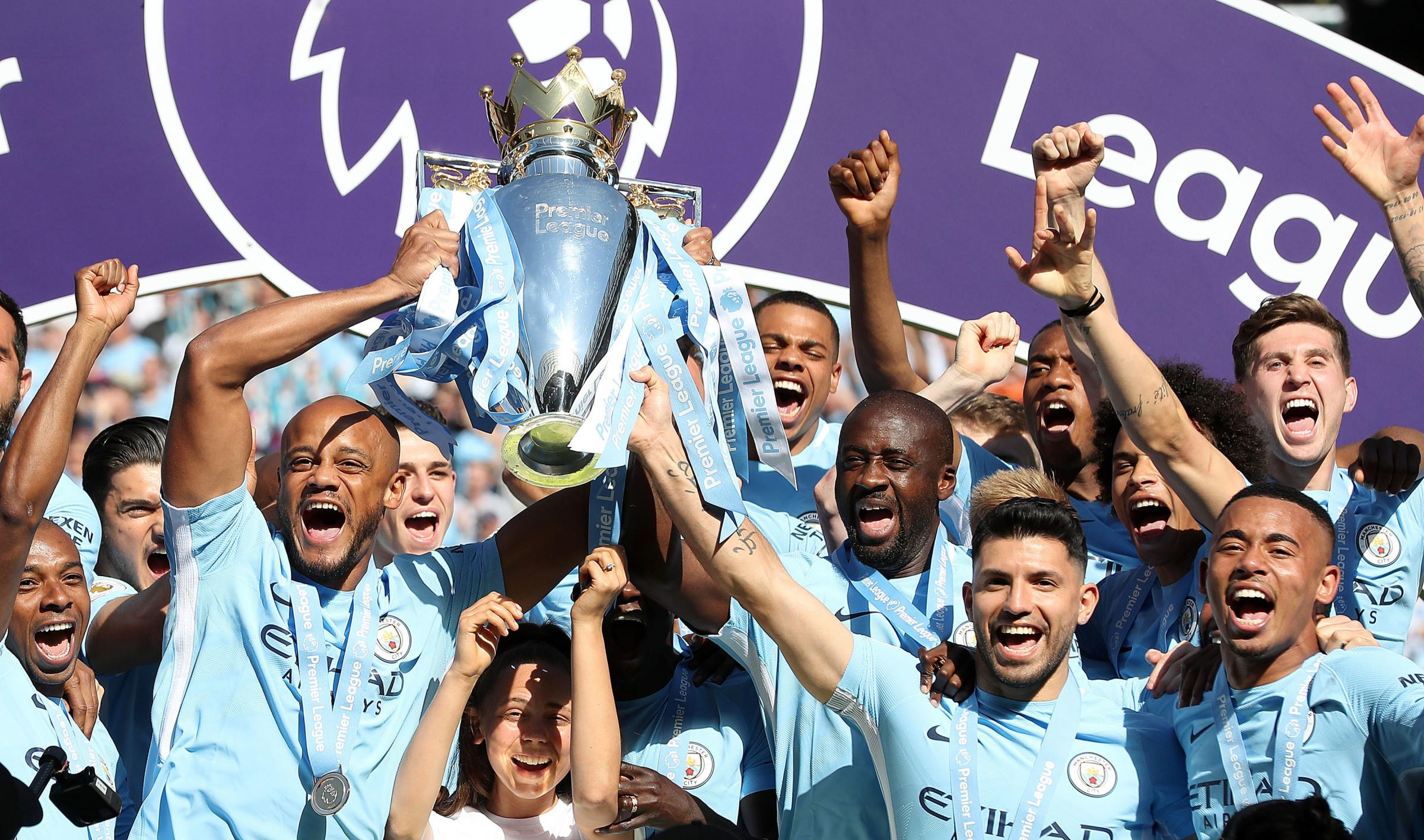 Manchester City's Vincent Kompany (left), Yaya Toure lift the premier league trophy. PRESS ASSOCIATION Photo