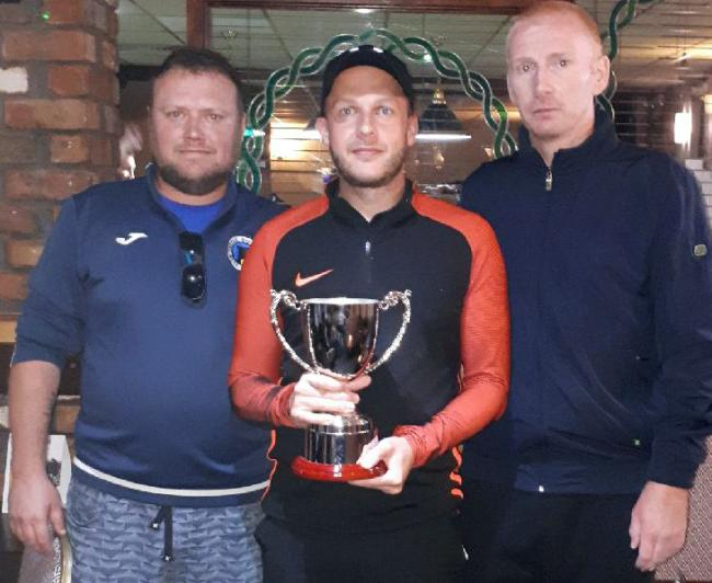Ryan Clark, centre, with organiser Adi Faulkner, left, and 2017 champion Sean Morrey following his victory in the Castle Classic final at the Northwich venue