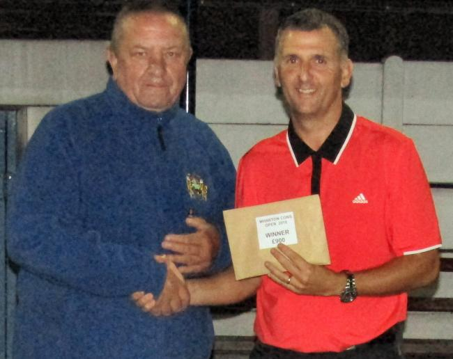 Graeme Wilson, right, receives his prize from Peter Walton, secretary of the bowls section at Wharton Cons, following his victory in Sunday's Open final. Picture: Barry Gibson