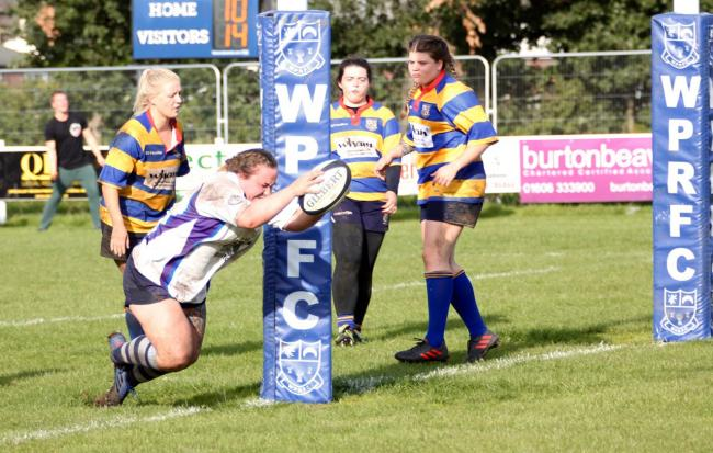 Laura Underdown dives over the line to score a decisive try for Winnington Park during a 17-14 victory against Burnley on Sunday. Picture: John Pickering