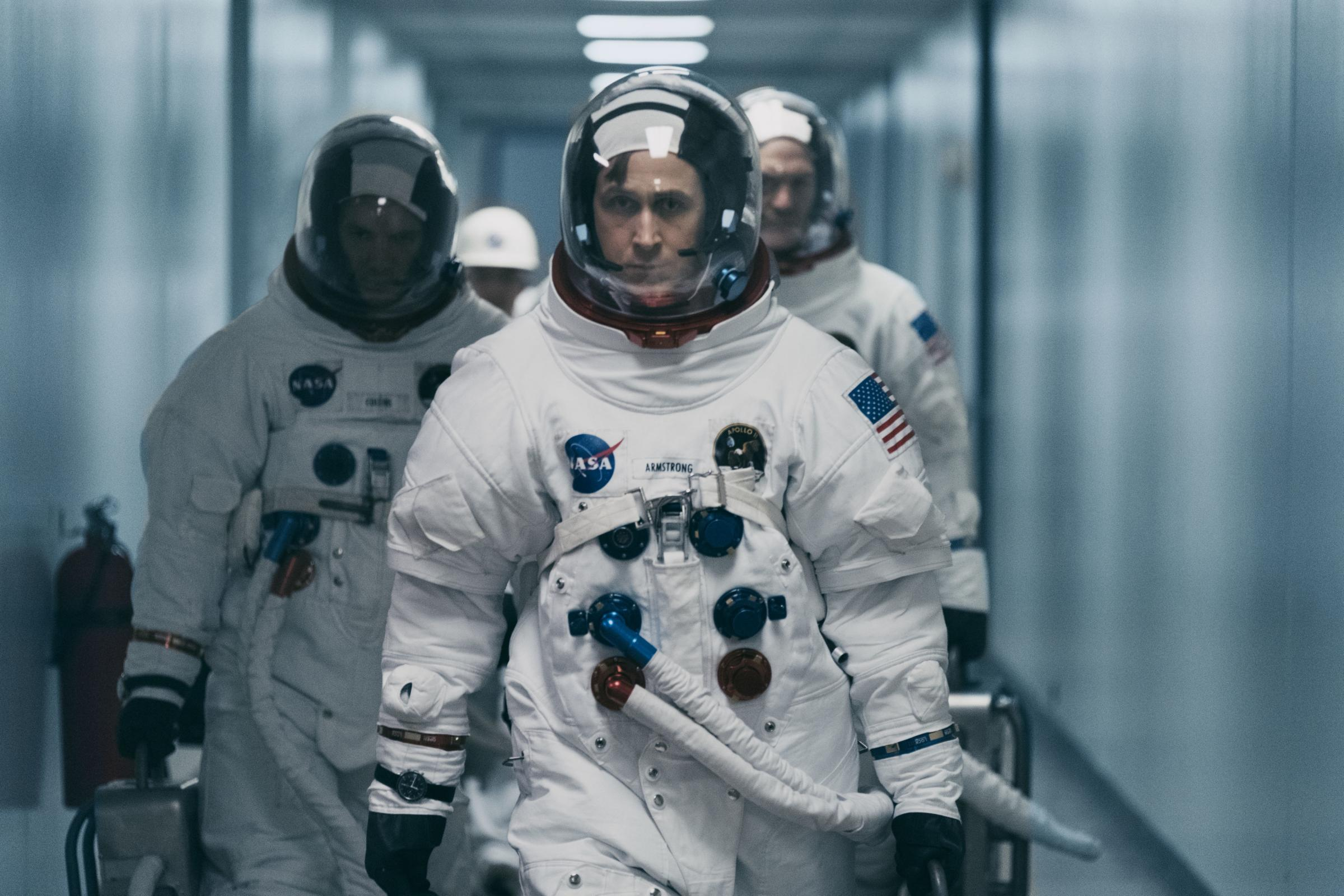 Lukas Haas as Michael Collins, Ryan Gosling as Neil Armstrong and Corey Stoll as Buzz Aldrin