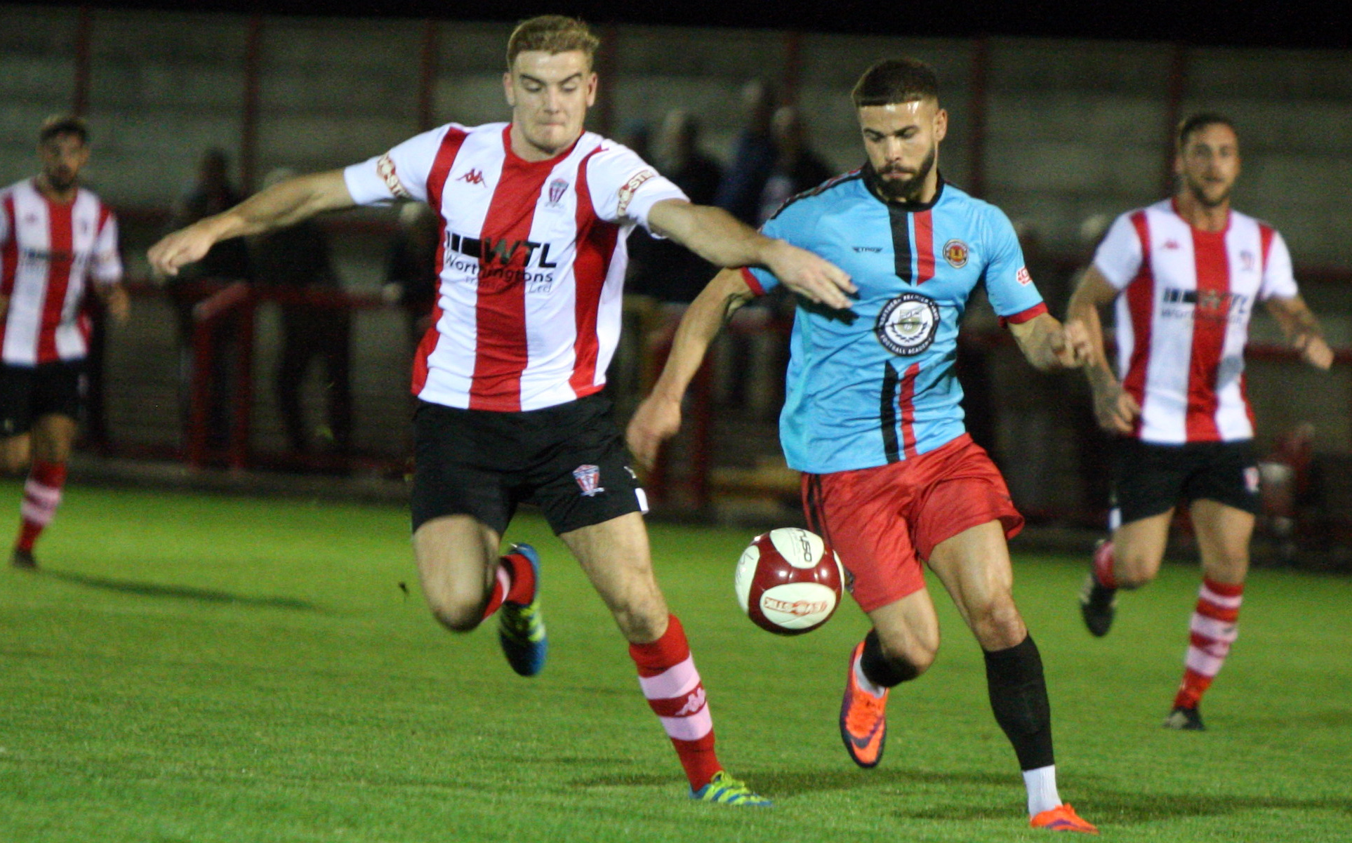 Josh Wardle, left, attempt to block Evan Garnett's path to goal during Witton Albion's defeat against Mickleover Sports on Tuesday. Picture: Keith Clayton