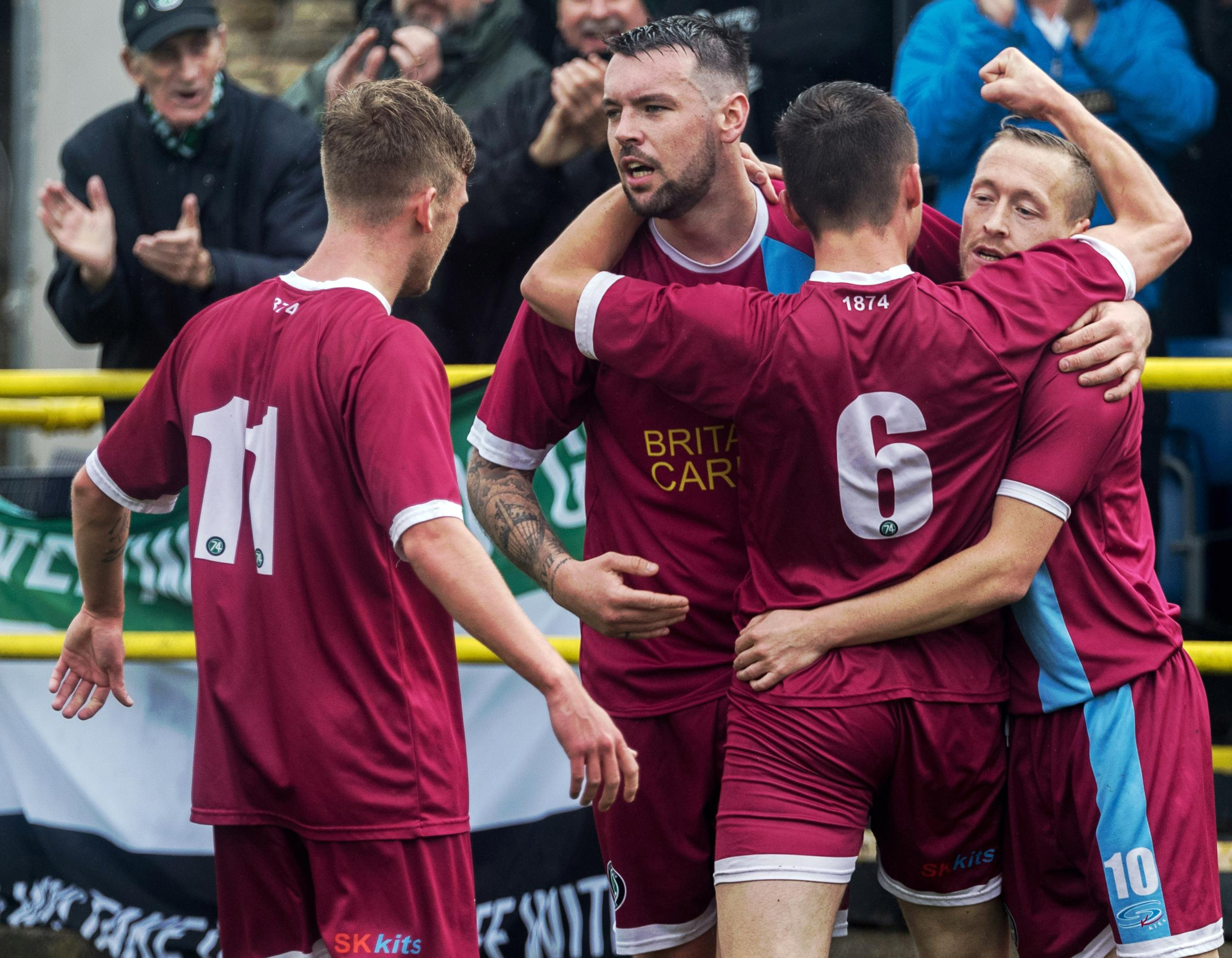 Scott McGowan, right, takes the acclaim of his 1874 Northwich teammates after scoring during their draw with Ashton Athletic on Saturday. Picture: Ian Dutton