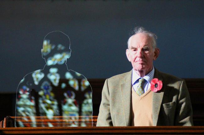 Lord Ashbrook sitting next to the silhouette dedicated to his grandfather, who died as a result of being wounded during the First World War