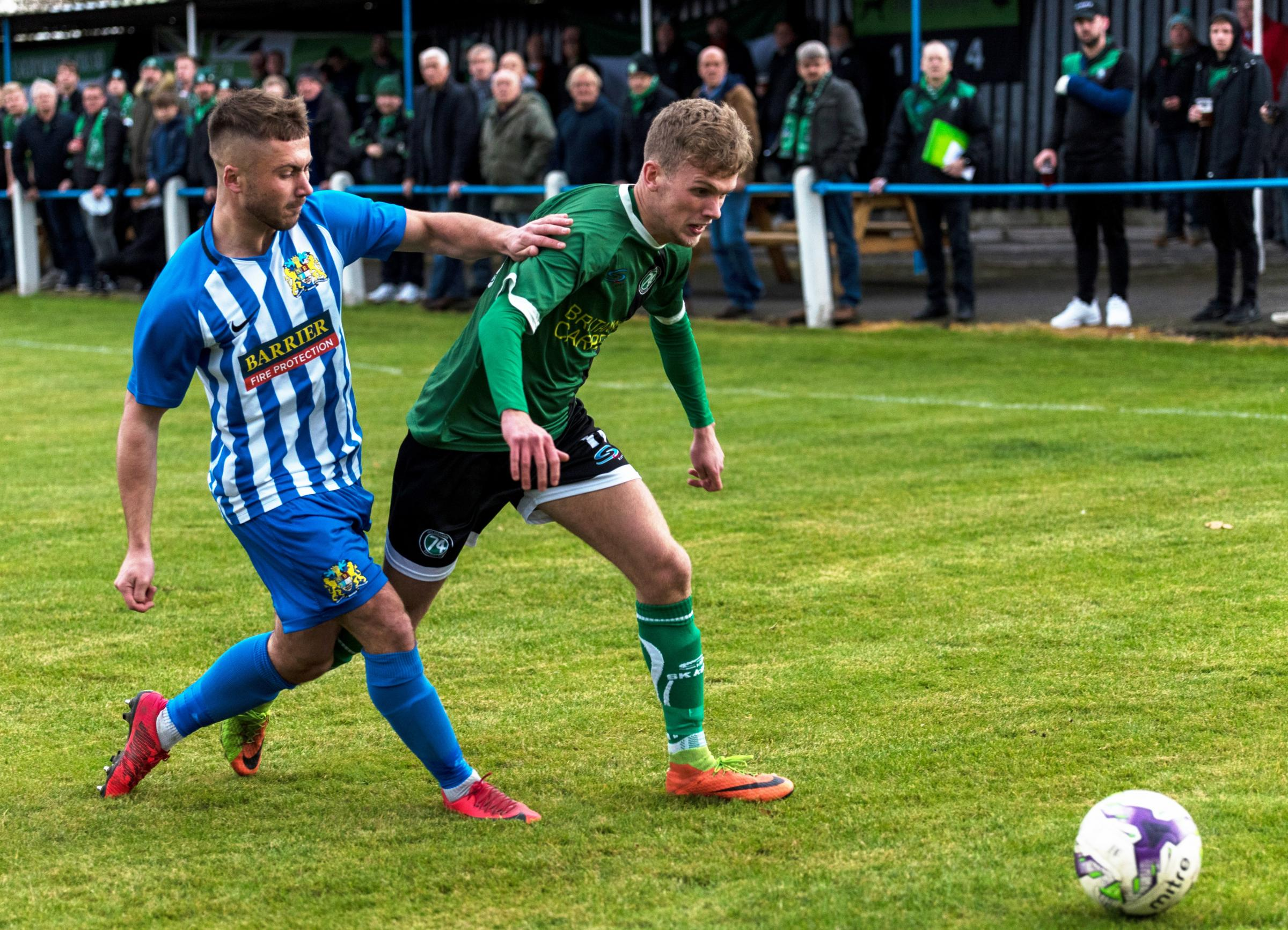 Taylor Kennerley attempts to escape the attention of an opponent during 1874 Northwich's FA Vase clash with Newcastle Benfield. Picture: Ian Dutton