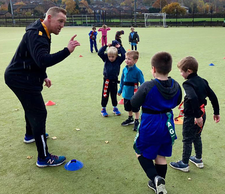 First-team player Chris James talks to children during one of the first Superstars sessions to be held at Northwich Rugby Club's Moss Farm home. They are free, and take place every Sunday morning