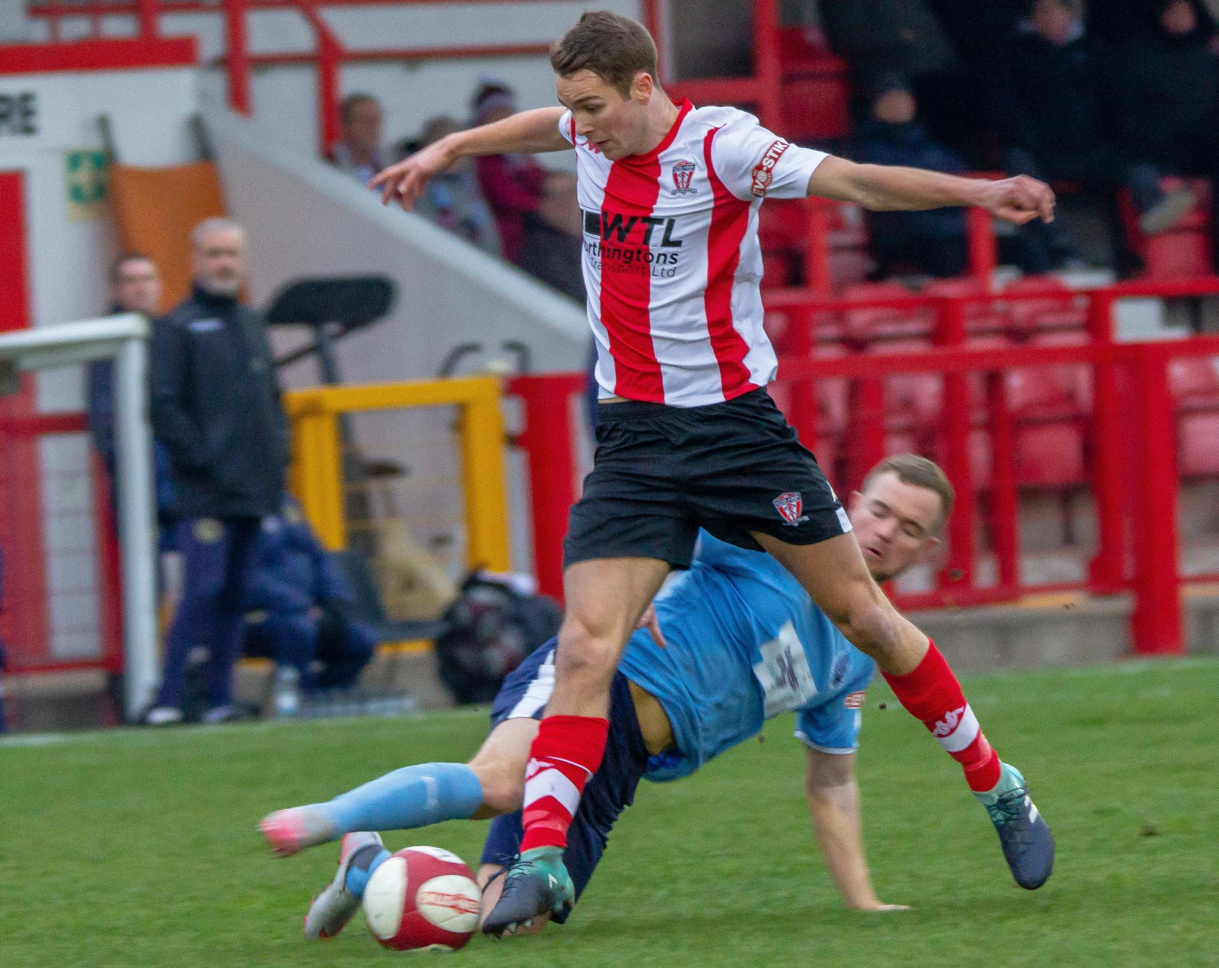 Billy Smart is challenged by an opponent during Witton Albion's 1-0 defeat against South Shields in the Northern Premier League's top-flight at Wincham Park on Saturday. Picture: Karl Brooks Photography