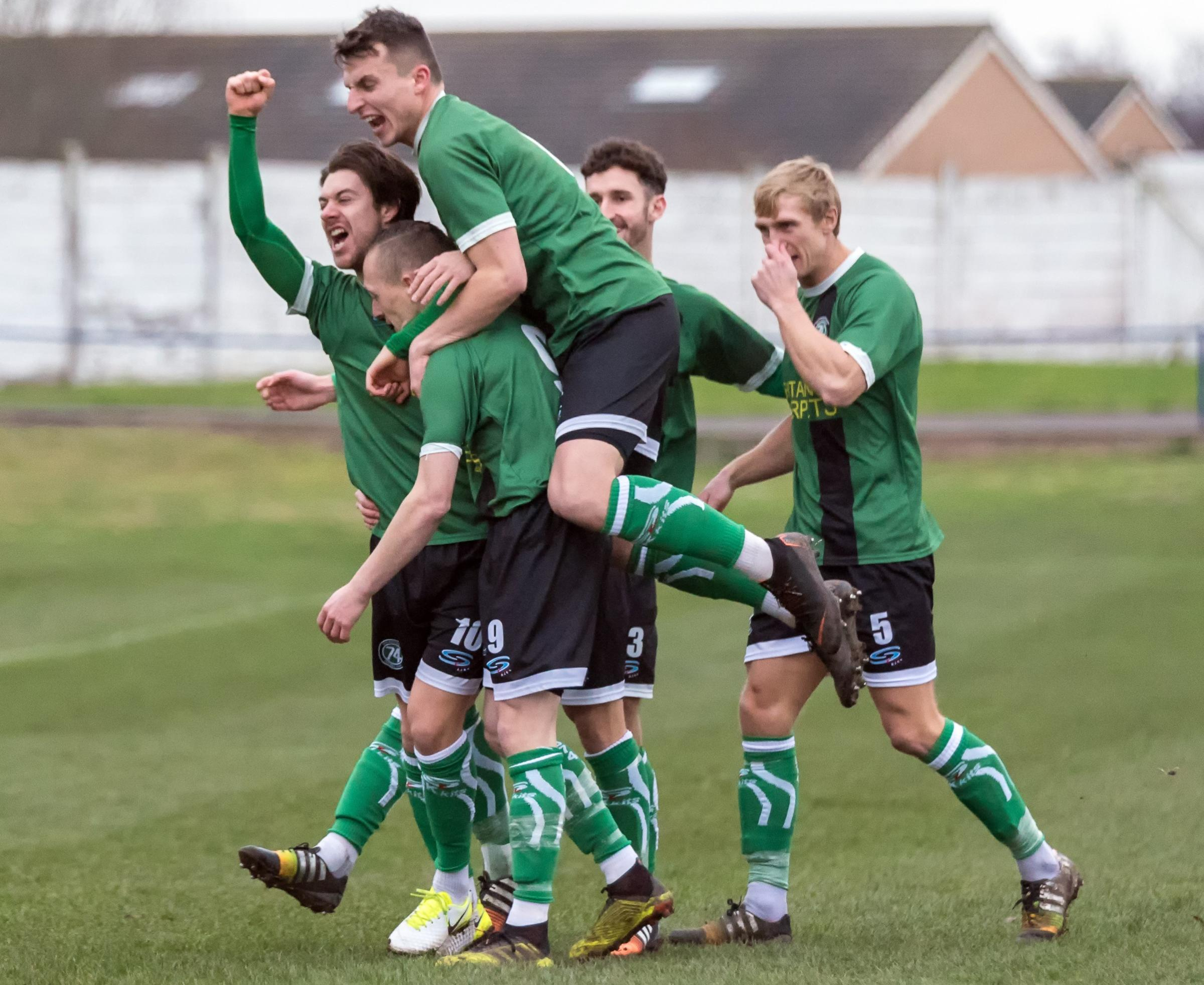 1874 Northwich players congratulate Scott McGowan after a rehearsed corner routine comes led to their opening goal against Congleton Town at Barton Stadium on Saturday. Picture: Ian Dutton