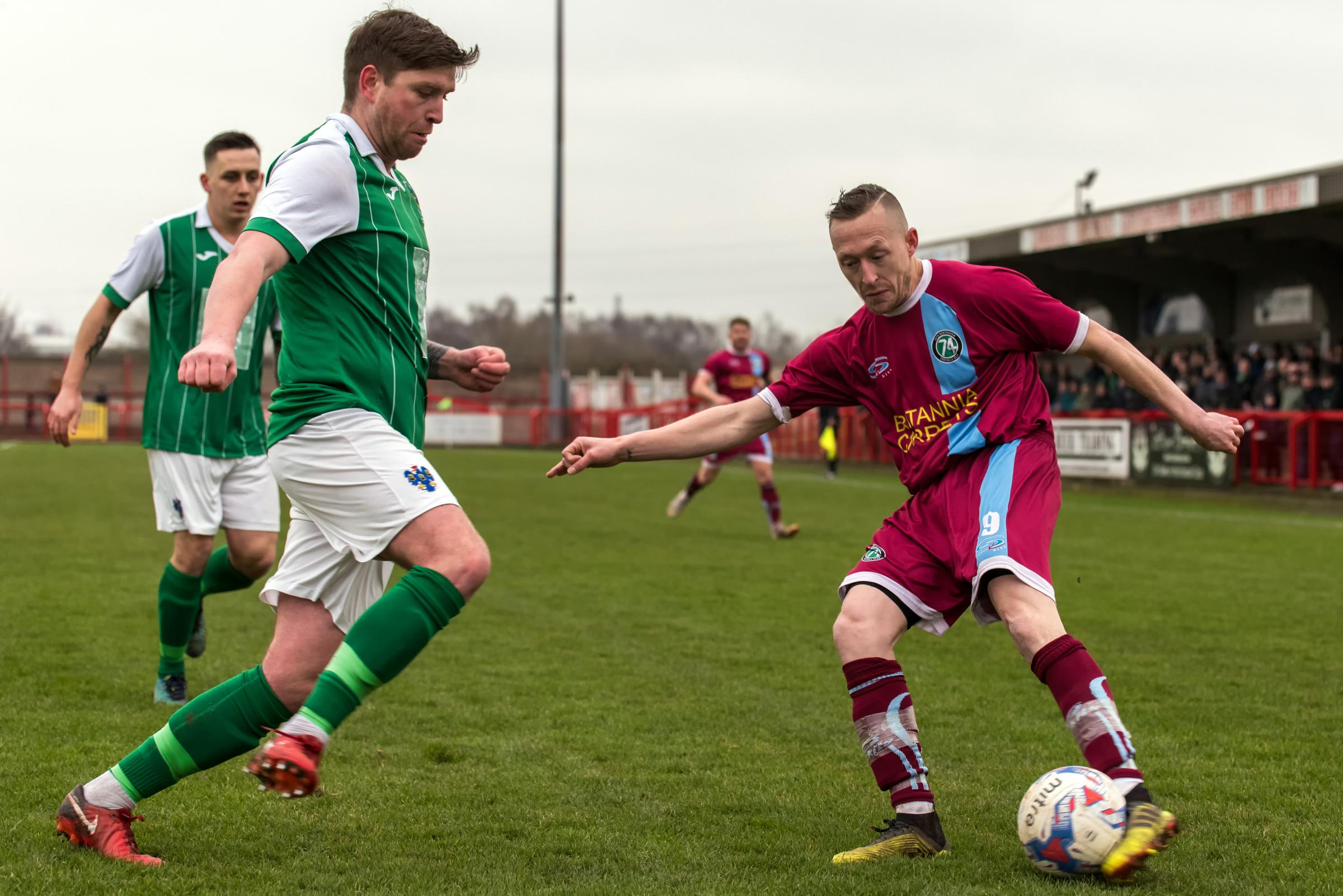 1874 Northwich front man Scott McGowan, right, is closed down by Northwich Victoria defender Andy Fitzgerald during Saturday's North West Counties League fixture at Wincham Park. Picture: Ian Dutton