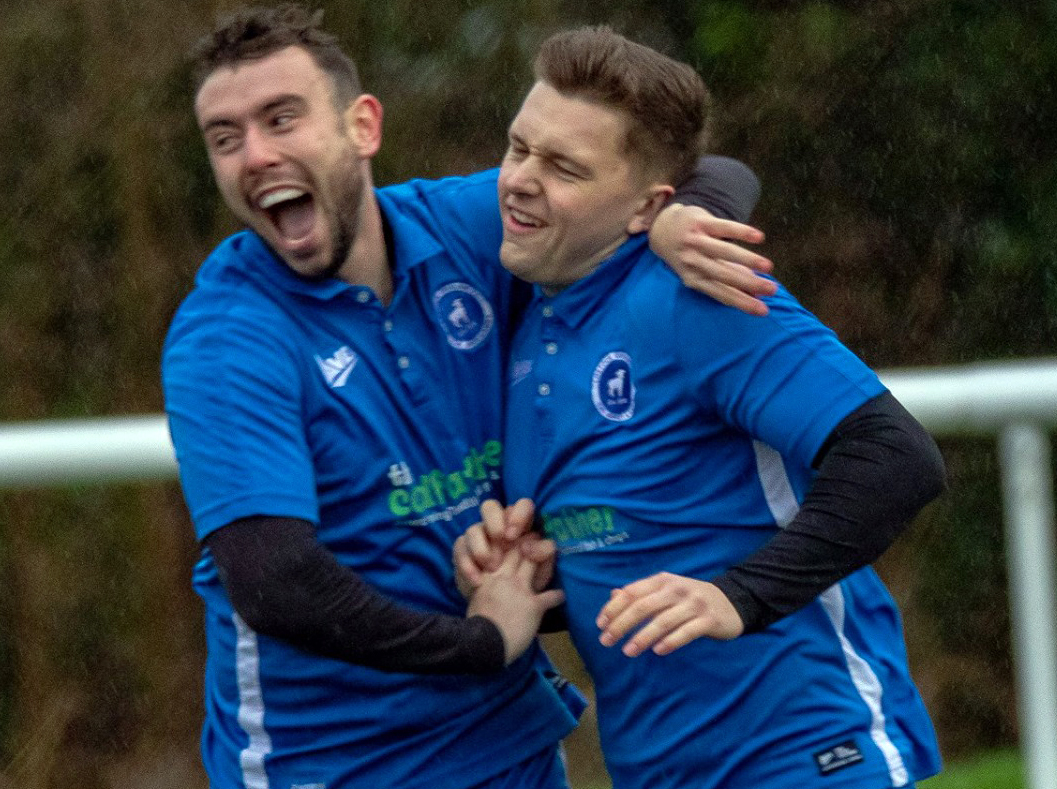 Substitute Jack Woolley, right, takes the acclaim of a Lostock Gralam teammate after scoring during their 2-1 defeat against Vulcan in Cheshire League One on Saturday. Picture: Karl Brooks Photography