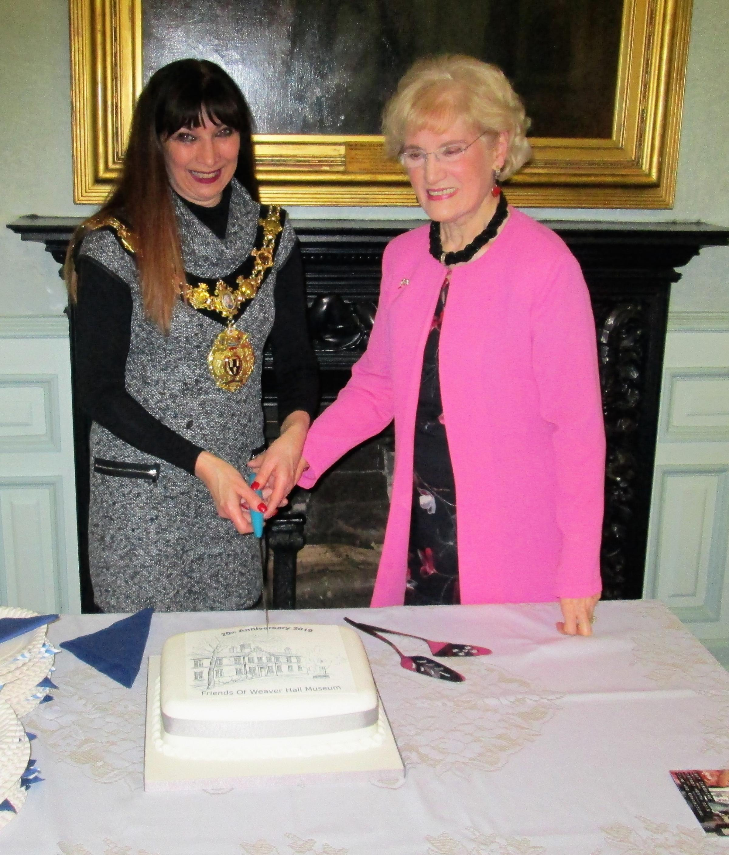 Town mayor Cllr Alison Gerrard cuts the cake at the celebration