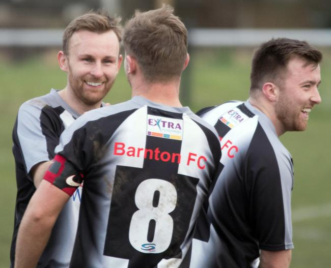 Matthew Rigby is congratulated by captain Sam Houghton after scoring for Barnton during a North West Counties League First Division South encounter with New Mills on Saturday. Picture: Robert Hardley