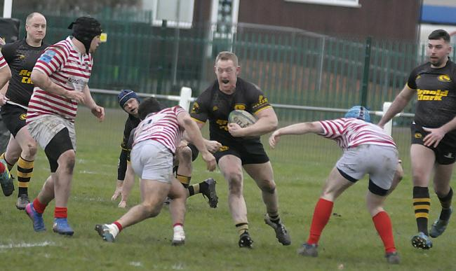 Hooker Chris James looks for a gap in Manchester's defence while in possession for Northwich during an unpredictable North One West encounter at Moss Farm last weekend. Picture: Mike Boden