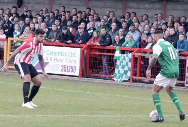 Darryhl Mason prepares to take on defender Pete Castle during a Northwich Victoria attack in their FA Vase quarter-finals success against Sholing at Wincham Park on Saturday. Picture: Ian Egerton