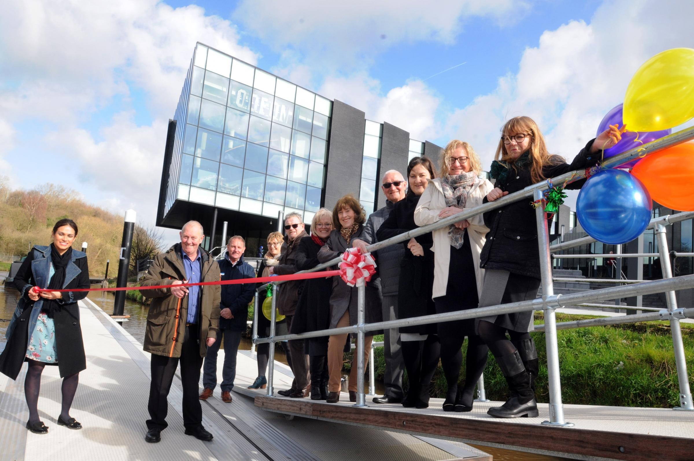 Cllr Brian Clarke cuts the ribbon at the official opening of the new Barons Quay pontoon