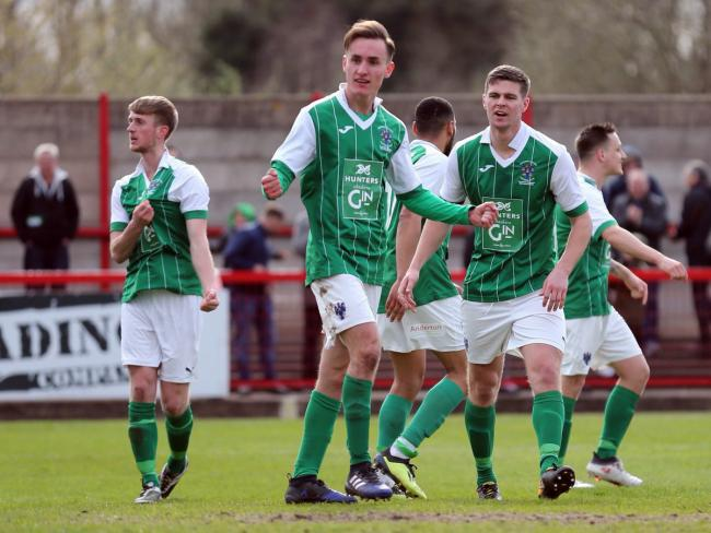 Harvey Whyte, centre, takes the acclaim of Northwich Victoria teammates after scoring an equaliser against Chertsey Town during an FA Vase semi-final first leg on Sunday. Picture: Jonathan White
