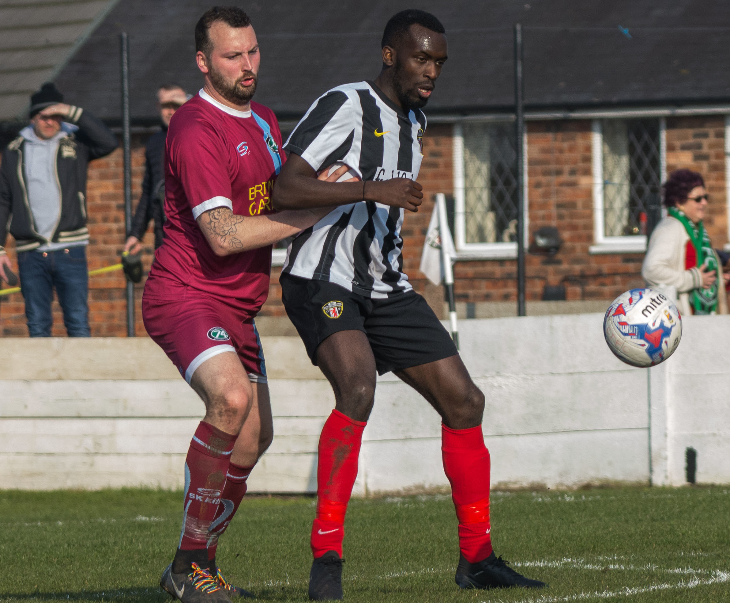 Danny Meadowcroft, left, and the rest of 1874 Northwich's defence kept out Congleton Town's Emini Adegbenro during last weekend's Macron Cup semi-final first leg at Booth Street. Picture: Ian Dutton