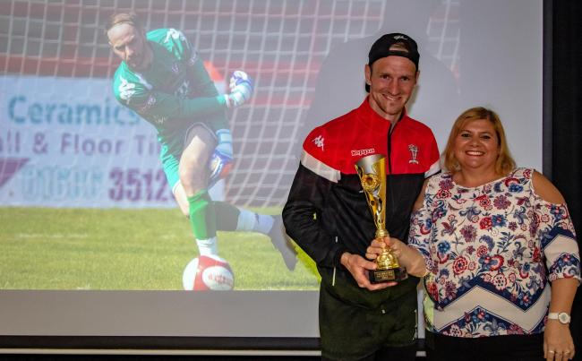 Greg Hall, left, is presented with the Supporters' Player of the Year award by Tracey Collins during Witton Albion's prize ceremony at Wincham Park on Saturday. Picture: Karl Brooks Photography