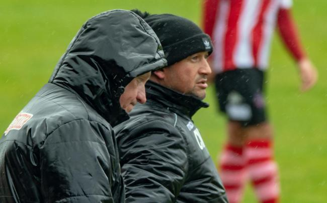 Gary Martindale, left, and Carl Macauley in grim conditions at Wincham Park during Witton Albion's draw with Hednesford on the Northern Premier League season's final day. Picture: Karl Brooks Photography