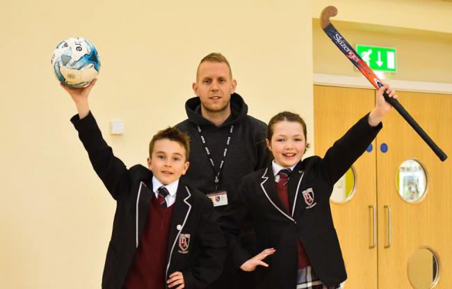 Natasha Cobb and Harry Fountain with PE teacher Tom Freeman