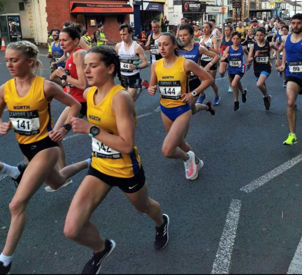 Northwich Guardian: Chloe Dooley, wearing 144, makes progress along with her North of England teammates during the Cardiff 5K
