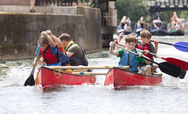 Scouts taking part in a River Weaver raft race in 2019. Photo by Christian Dobbie