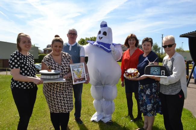 From left to right; Ellie Churchill, Emma Jump, Geoff Walsh, Marshmallow Man, Karol Roberts, Pauline Newton and Stephanie Bateson