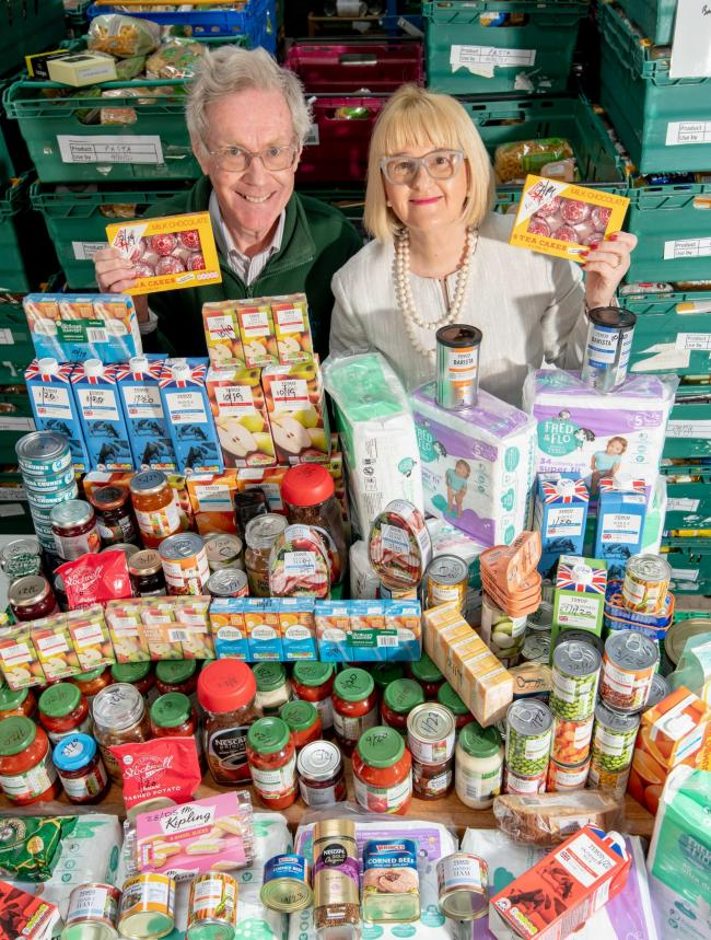 Adrew Mallin-Jones, the Warehouse Duty Manager at Mid Cheshire Foodbank and Barratt Homes North West Sales Manager, Kate Burrows