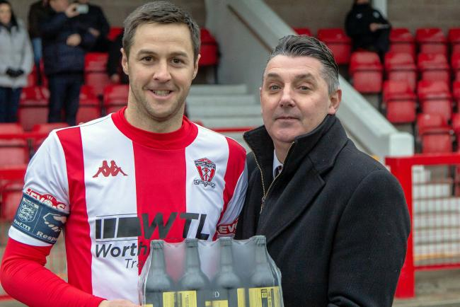 Chairman John Salmon, pictured right presenting a player of the month award to Rob Hopley, has called on Witton Albion's supporters to help cover the club's short-term running costs. Picture: Karl Brooks Photography